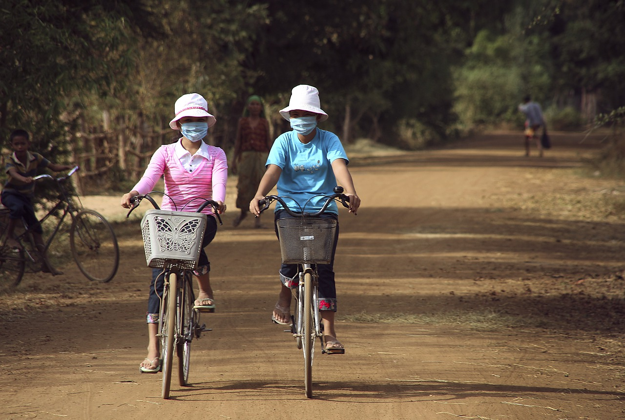 bike riders with masks on covid 19